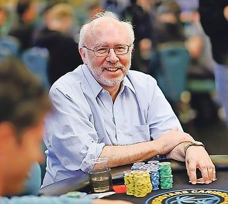 Buddhist wins $670,000 in poker tournament, gives it to charity
